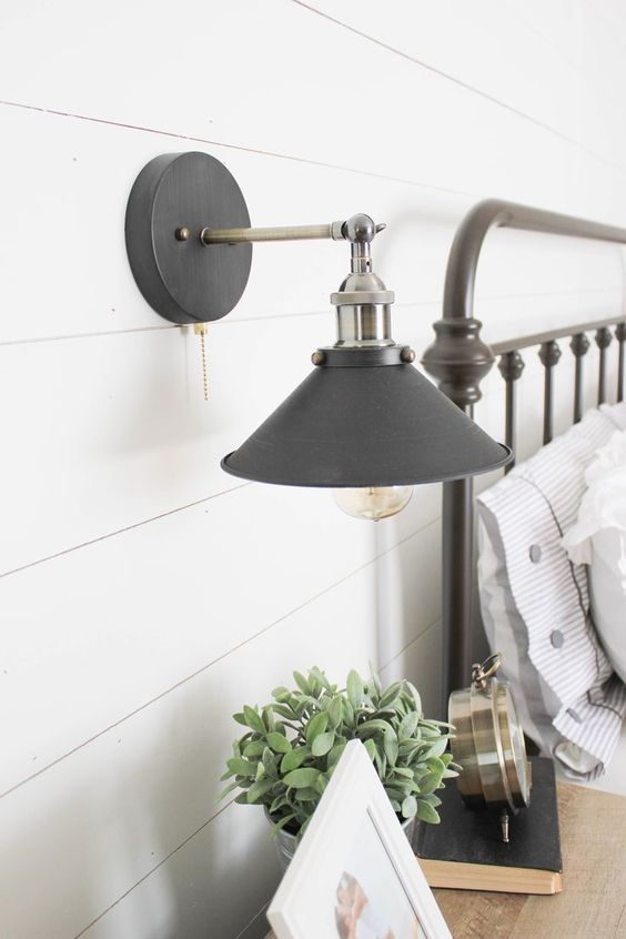 industrial sconce lighting in stainless steel and matte black for a farmhouse space