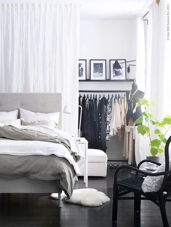 a Scandinavian space with a closet hidden behind the curtains is a perfect idea