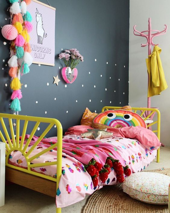 a bold and colorful girl's room with a single black wall to look calmer