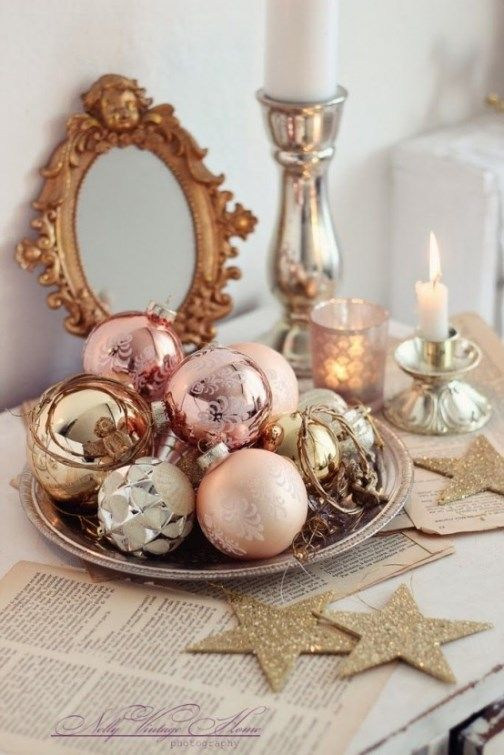 a tray with gold, copper, silver and pastel pink ornaments is a great holiday display