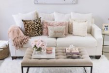 18 faux fur in grey and blush and a leopard pillow add glam to this living room