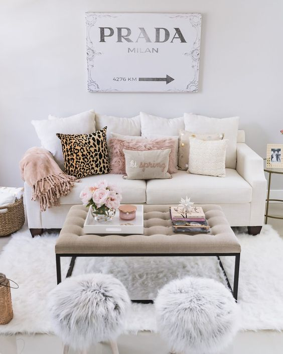 faux fur in grey and blush and a leopard pillow add glam to this living room