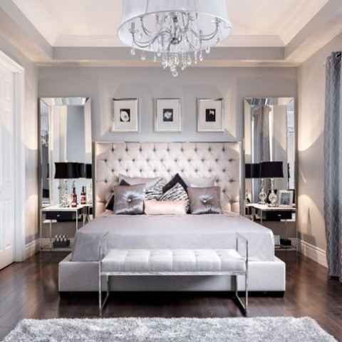 large mirrors on the wall and shiny textiles make the bedroom glam like