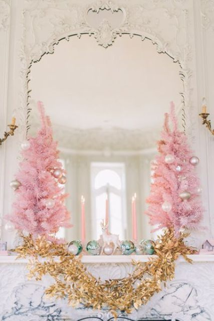 pink Christmas trees with pearly ornaments, mint ornaments and a gold garland for a glam mantel