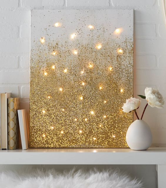 a glitter gold artwork with lights is an easy DIY to make