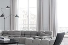 19 a stunning minimalist space with a statement grey upholstered sof and lilac curtains