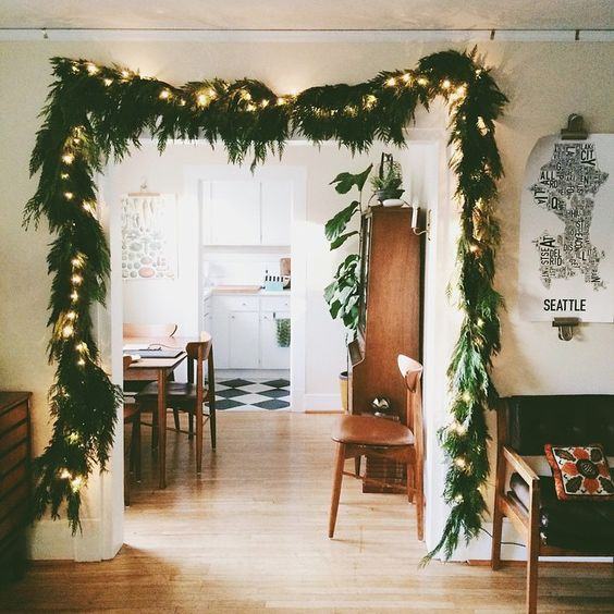 an evergreen garland with lights will highlight any entry