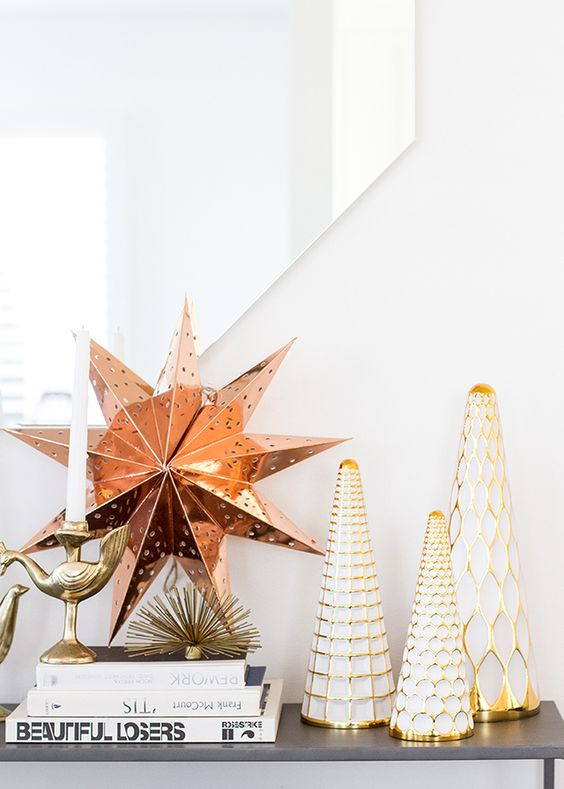 gold and copper Christmas decor - Christmas trees and a large star