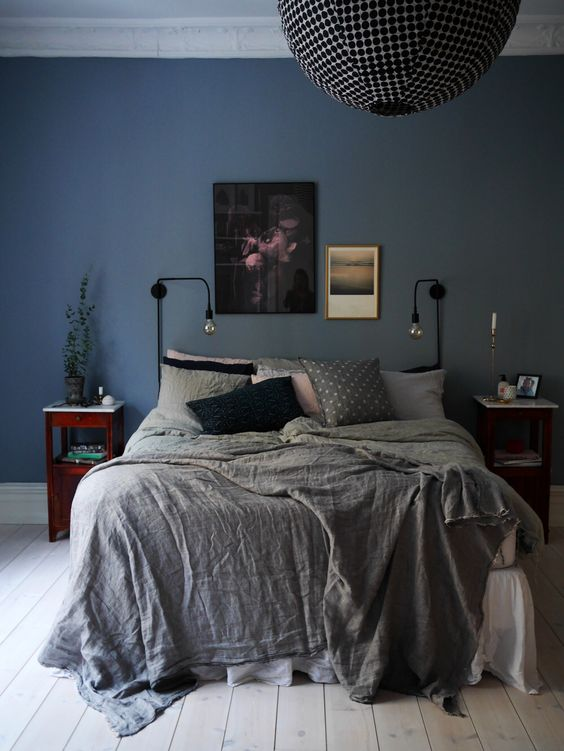 simple black wall sconces with bulbs are great for different bedroom styles including eclectic