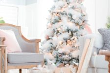 20 a flocked Christmas tree with copped ornaments and lights looks very chic and glam