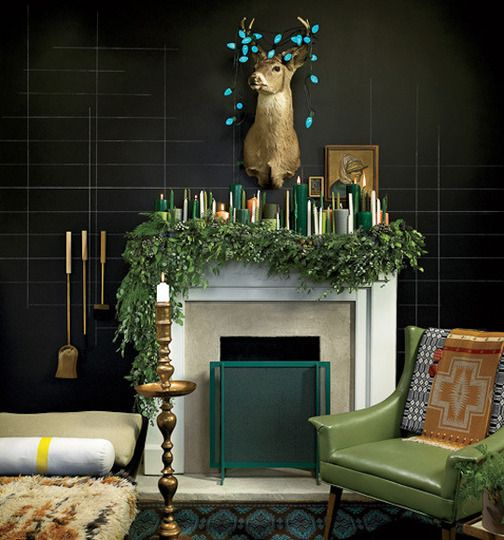 a lush evergreen garland and lots of candles in the shades of green and gold make an edgy look