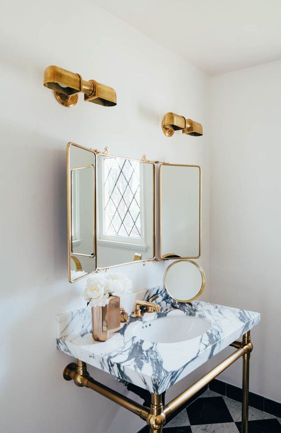 a marble vanity countertop, brass lamps, frames and legs for a vintage glam space