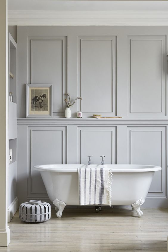 a neutral bathroom with grey paneled walls looks cool and refined