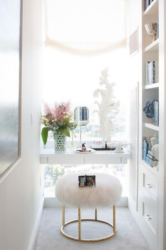 a vanity built in next to the window is a great idea to get much natural light