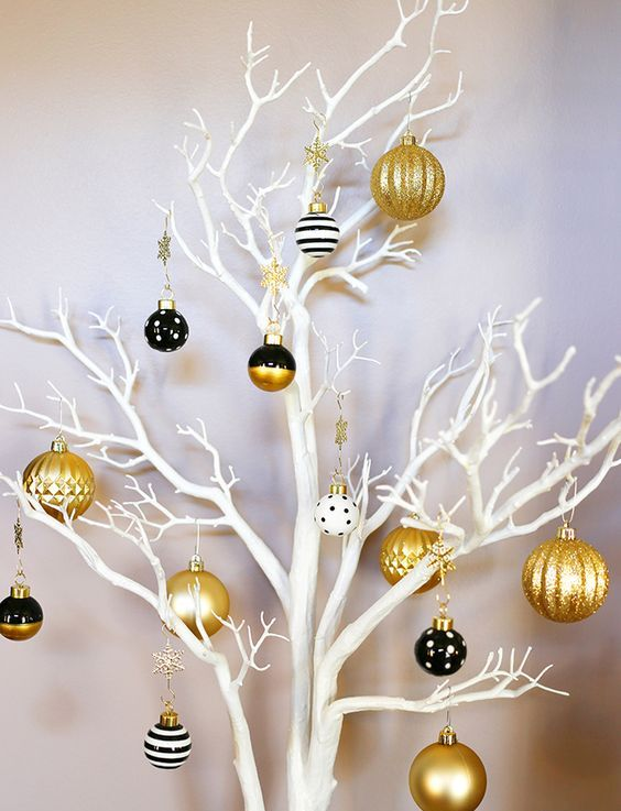 a fresh take on a Christmas tree   white branches, gold and black ornaments