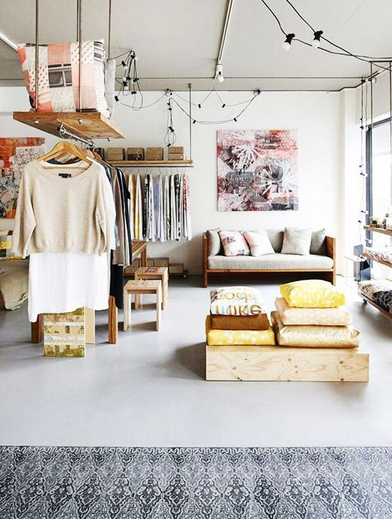 a large open space with cool makeshift closets used for space separating