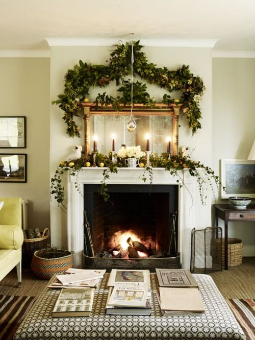 a lush evergreen garland with citrus, white blooms and a lush garland over the mantel