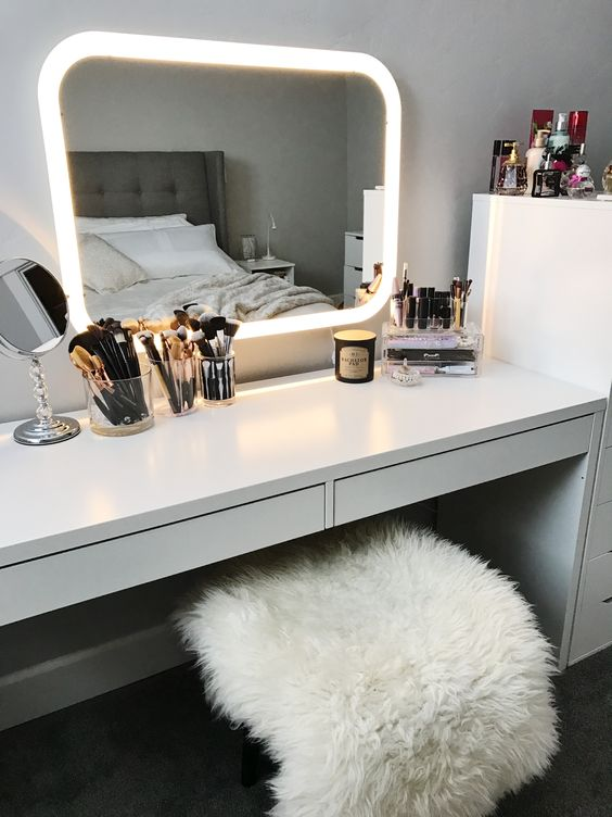 a mirror with integrated lights in the frame is a super functional and modern idea