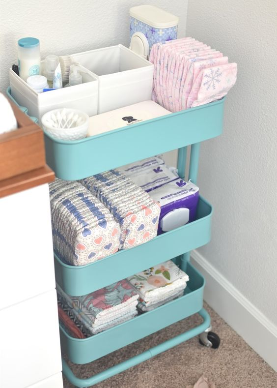 an IKEA cart turned into a changing table storage is a smart idea