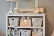22 a whitewashed dresser with baskets to store all the stuff your kids need