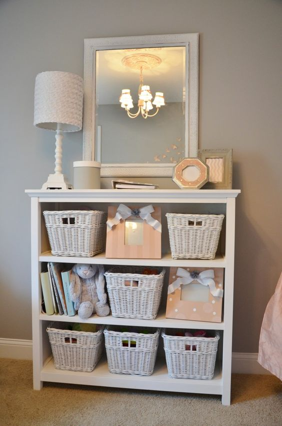 a whitewashed dresser with baskets to store all the stuff your kids need