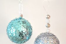 22 cute shiny blue and silver sequin ornaments with additional beads for Christmas