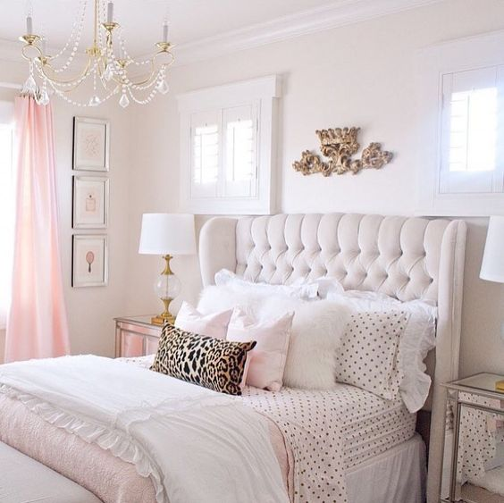 dramatic upholstered headboards and feminine bedding are gorgeous idea for a girlish bedroom