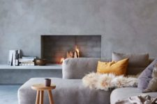 23 a concrete fireplace wall and brick clad inside looks very minimalist and interesting