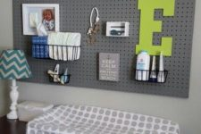 23 a pegboard over the changing table is a great idea to accomodate a lot of storage