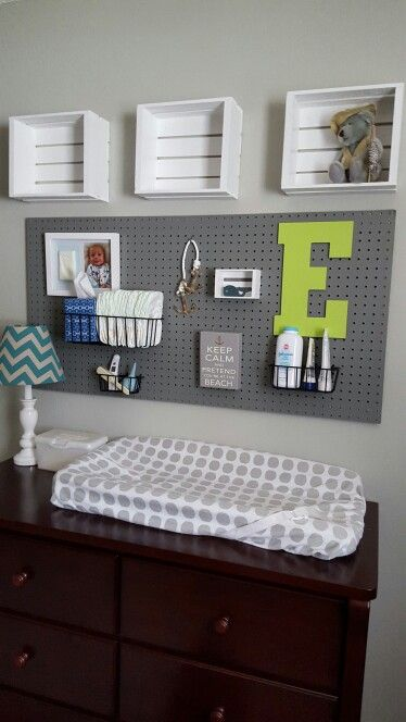 a pegboard over the changing table is a great idea to accomodate a lot of storage