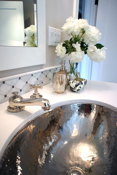 a shiny silver sink and matching faucets are great for a glam bathroom