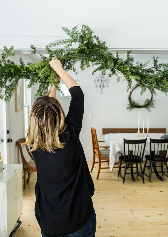 a simple evergreen garland attached over the entry to the dining space