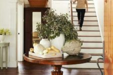 23 a vintage rustic table in the entryway can be used for various displays, seasonal and holiday ones
