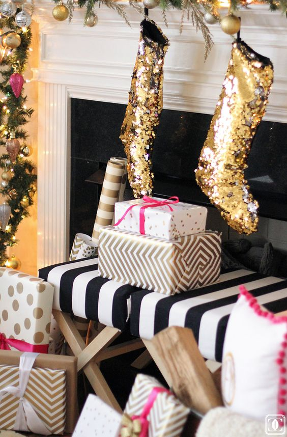 gold glitter stockings will add a fun and glam touch to the mantel