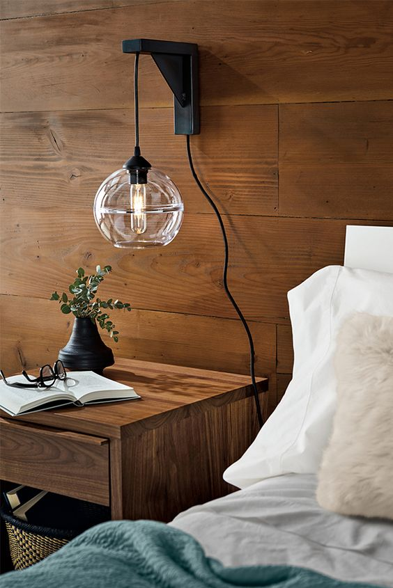 a gorgeous sconce and pendant lamp in one, a metal base and a glass shade