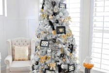 24 a modern glam Christmas tree with gold, black and white decor and ornaments, letters and feathers