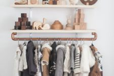 24 open shelves with copper railing is a chic modern idea for any nursery