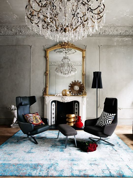 vintage glam with a dramatic effect, a large vintage mirror and a crystal chandelier for a cool look