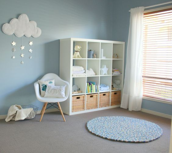 a comfy IKEA dresser with open shelves and baskets for toys looks pretty