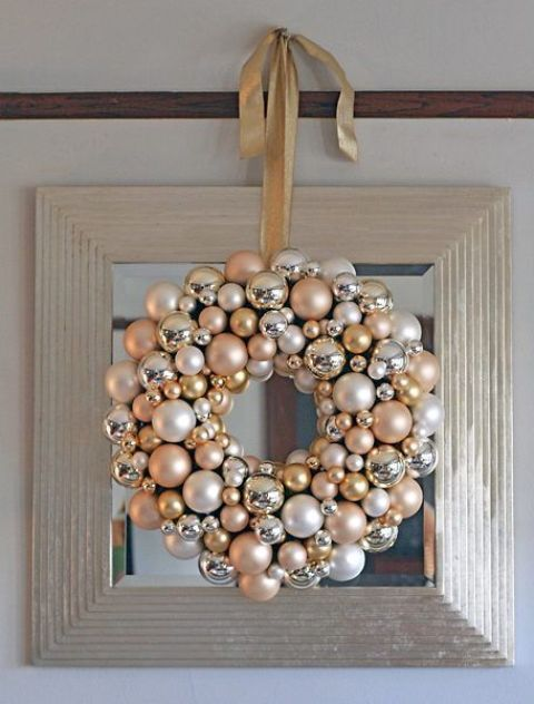 a glam champagne, silver and pearl ornament wreath is a great piece to DIY