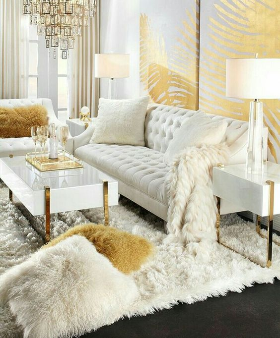 a luxurious glam living room done in cream and gold looks really wow