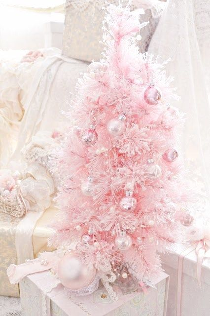 a pink Christmas tree with pearly and pink ornaments looks very sweet and glam