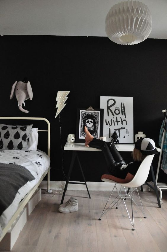 a stylish black and white space for a little rock-n-roller should be done with a black wall, of course