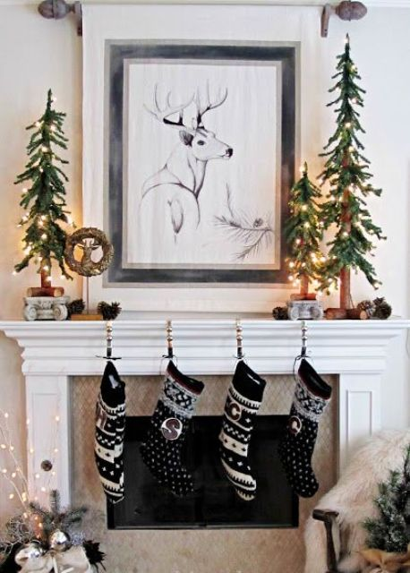cute printed stockings in black and white, Christmas trees made of fir branches and lights for a woodland feel