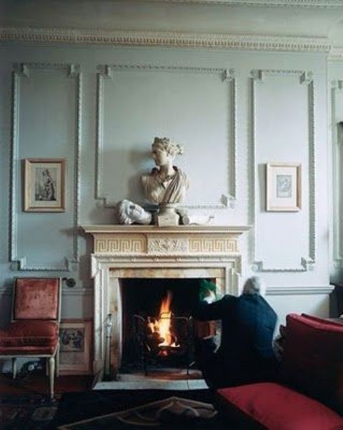 gorgeous mint-colored paneled walls and a fireplace clad with marble