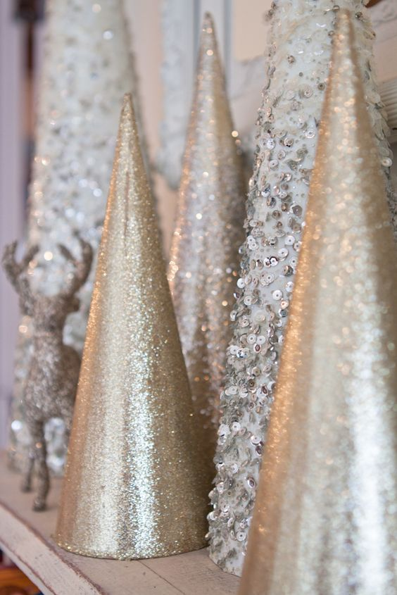 shiny Christmas tree cones of champagne glitter paper and silver sequins for a shiny touch