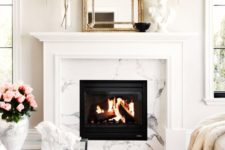 26 a glam clad fireplace, a zebra print rug, a vintage mirror and an acrylic table to add a refined glam feel