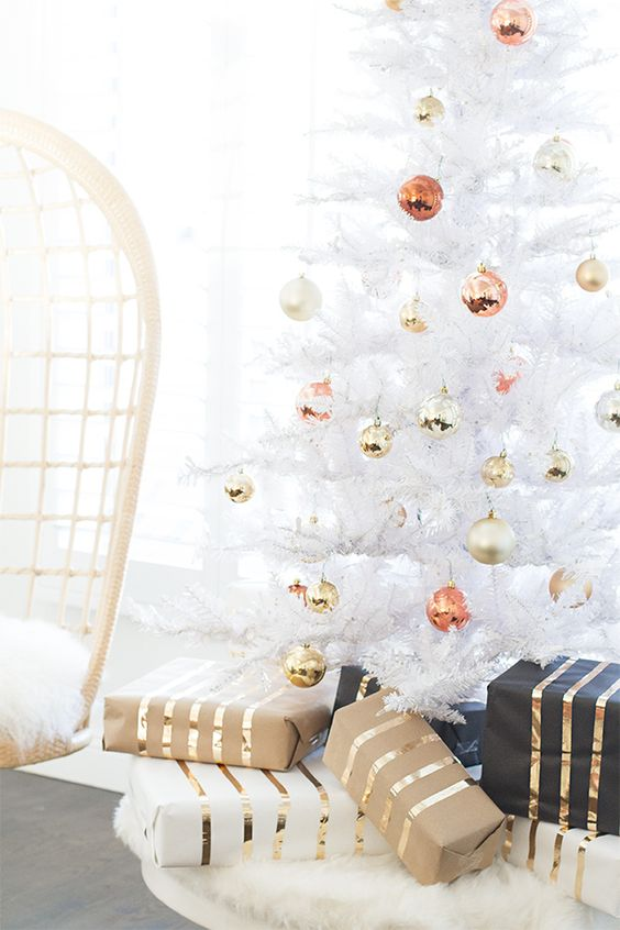 a pure white Christmas tree with ornaments of mixed metal colors looks glam and stylish
