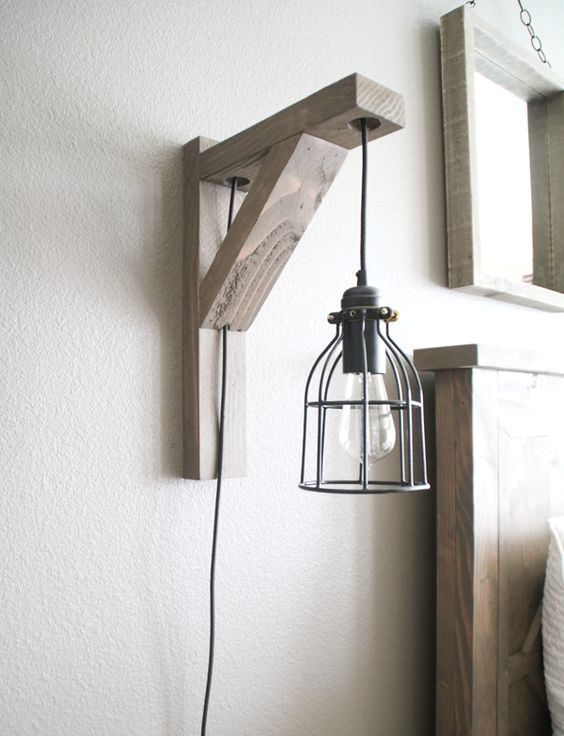 a wood and metal wall sconce that combines and pendant lamp and a sconce in one