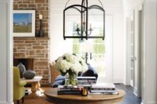 26 a wood pedestal table with books and a vase serves a great eye-catchy piece